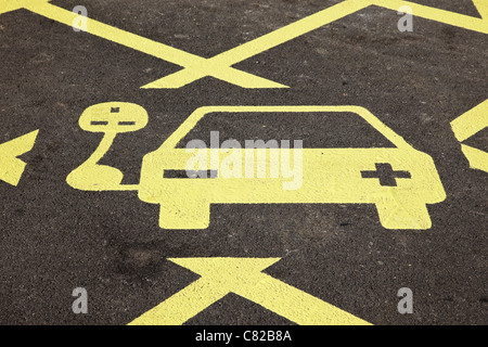 Ecotricity free electric charging point sign for recharging electric battery powered vehicles in a motorway service - Stock Photo