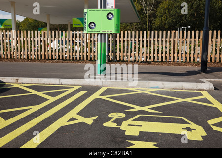 Ecotricity free electric charging points for recharging electric battery powered vehicles in a motorway service - Stock Photo