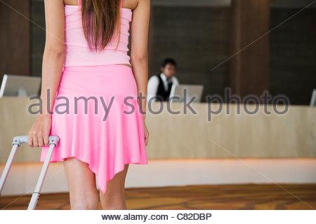 Woman in hotel lobby - Stock Photo