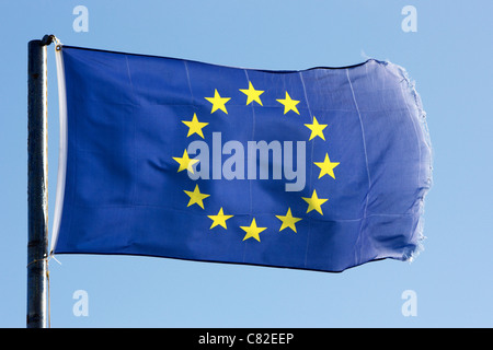 eu flag with frayed edges flying - Stock Photo