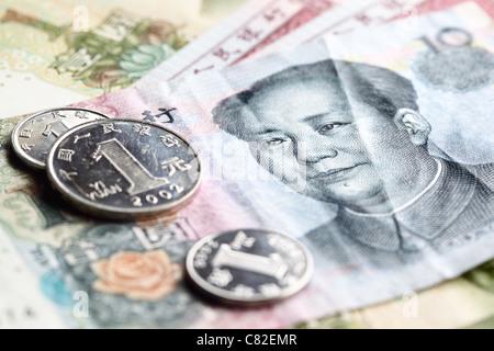 Chinese yuan renminbi banknotes and coins close-up - Stock Photo