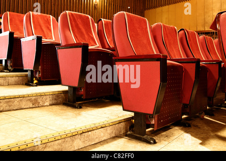 Empty red theater seats close up - Stock Photo