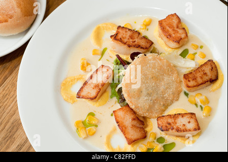A Salad of seared scallops and sweetcorn at The Checkers restaurant in Montgomery Powys mid wales, awarded one star - Stock Photo
