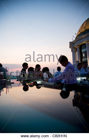 Thailand, Bangkok, Sirocco Bar, on State Tower Buiding, People relax in the bar. - Stock Photo