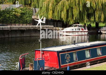 small wind turbine on a barge boat - Stock Photo