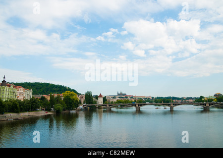 Beautiful Prague bridges and quays - view from the river Vltava - Stock Photo