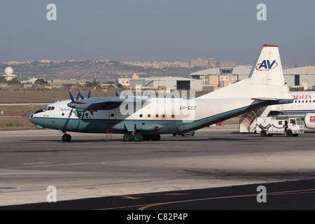Aerovis Airlines Antonov An-12 cargo plane parked on airport ramp - Stock Photo