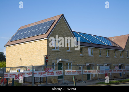 Somerset England UK Solar panels fitted on the roof of newly built affordable housing public private sector partnership - Stock Photo