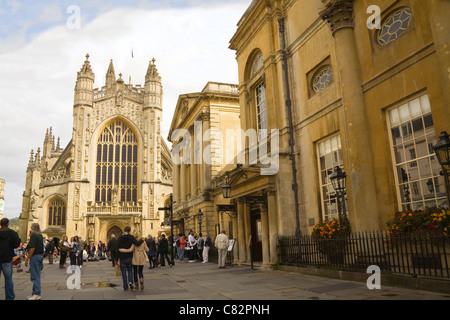 Bath Somerset England UK Tourists outside the entrance to the Roman Baths Pump Room and Abbey of this historic city - Stock Photo