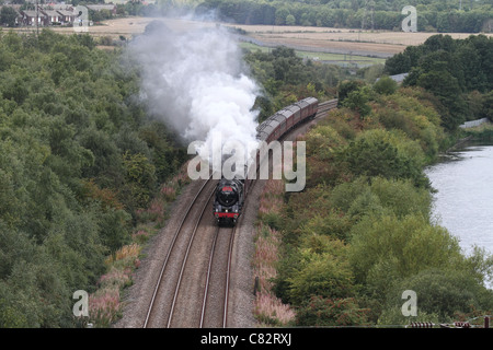 Scarborough express Steam locomotive  train with smoke running on tracks - Stock Photo