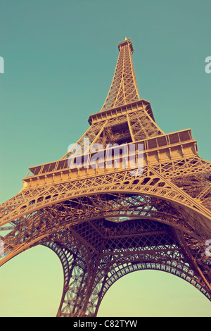 Eiffel tower photographed in vintage style from below - Stock Photo