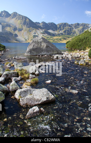 Steam coming from Lake Wielki in the Valley of the Five lakes, Poland - Stock Photo