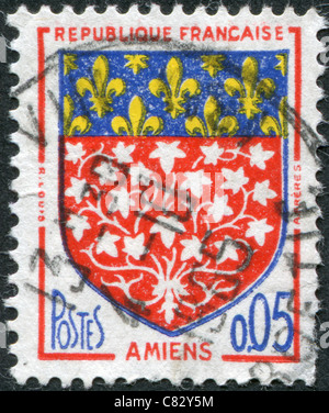 FRANCE - 1962: A stamp printed in France, depicts Arms of Amiens - Stock Photo