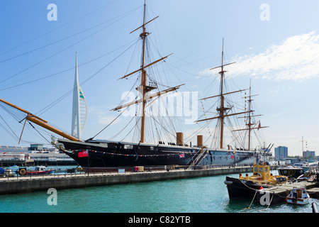 HMS Warrior ( first iron-hulled steam/sail warship from1860) with Spinnaker Tower behind, Portsmouth Historic Dockyard, - Stock Photo