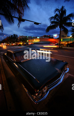 classic hotrod car in front of miami ink tattoo parlor, miami beach, florida, usa - Stock Photo