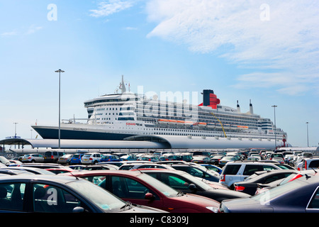 The cruise liner Queen Mary 2 viewed across a car park at Ocean Terminal, Southampton Docks, Southampton, Hampshire, - Stock Photo