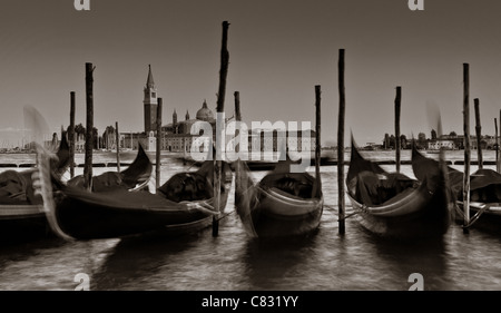 Gondolas tied up at San Marco with San Giorggio Maggiore in the distance, Venice, Italy - Stock Photo