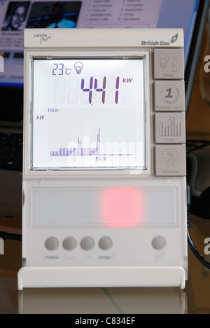 A domestic British Gas Smart Meter in 'electricity' mode, with red light indicating high energy consumption. UK - Stock Photo