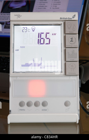 A domestic British Gas Smart Meter in 'electricity' mode, with amber light indicating average energy consumption. - Stock Photo
