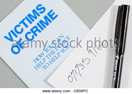 Top down view of a victims of crime pamphlet, England, UK - Stock Photo