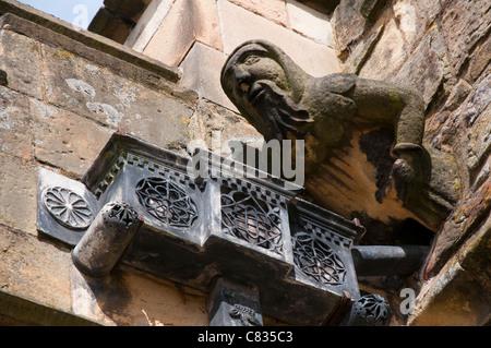 A gargoyle at Haddon Hall in Derbyshire England UK - Stock Photo