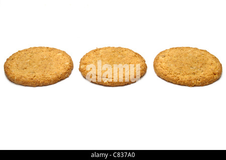 Three cookies in a row isolated on white - Stock Photo