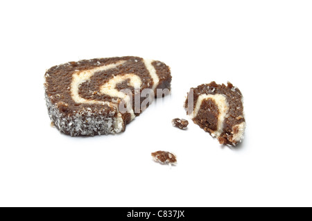 Coco roll slice with crumbs isolated on white - Stock Photo