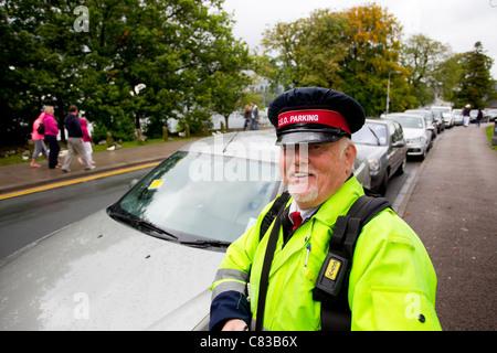 Traffic Warden Civil Enforcement Officer Parking Attendant wearing CCTV - Stock Photo