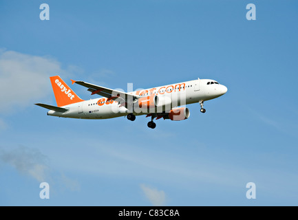 EasyJet Airbus A320-214 Airliner G-EZUA Landing at Gatwick International Airport West Sussex England United Kingdom - Stock Photo
