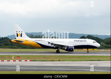 Monarch Airlines Airbus A320-212 Airliner G-OZBB Landing at Manchester International Airport England United Kingdom - Stock Photo