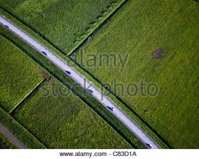 Paved road through rural landscape - Stock Photo