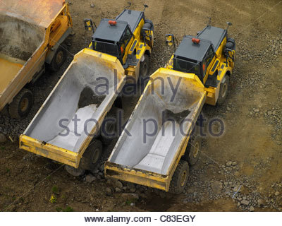Dump trucks parked in quarry - Stock Photo