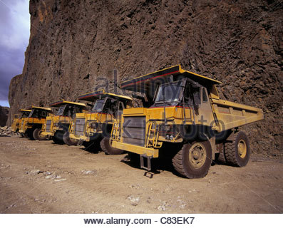 Dump trucks parked at quarry - Stock Photo