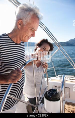 Older couple sailing together - Stock Photo