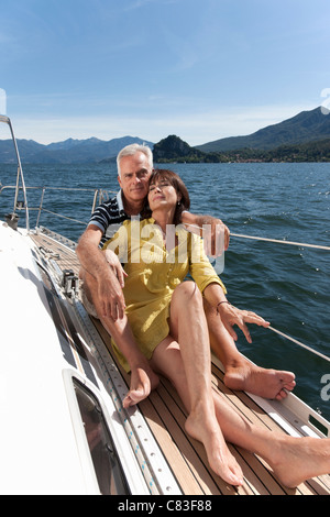 Older couple relaxing on sailboat - Stock Photo