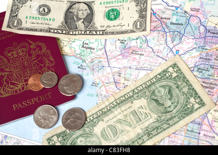 US money and a passport on a map of Los Angeles - Stock Photo