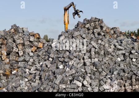 Scrap metal cubes in a scrap yard - Stock Photo