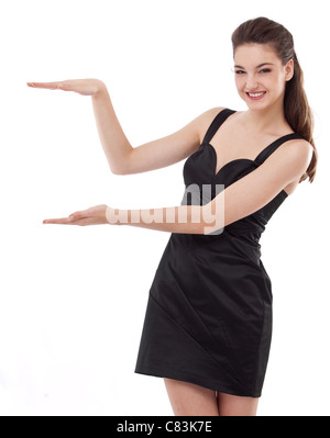 Portrait of attractive young girl in a black dress. - Stock Photo