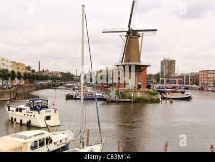 The windmill at Delfshaven, Rotterdam, Netherlands and boats in the harbour - Stock Photo