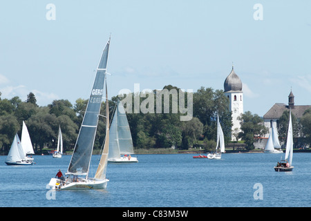 Sail Boats on the Chiemsee with the Fraueninsel in the background, Chiemgau Upper Bavaria Germany - Stock Photo