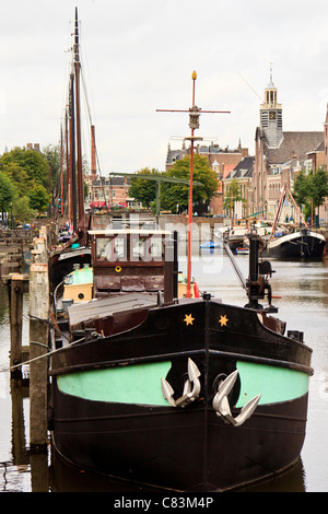 Wooden Dutch sailing barges in the harbour at Delfshaven, Rotterdam, Netherlands - Stock Photo