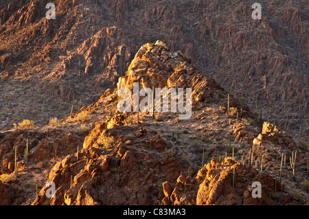 late afternoon light reflecting on mountain top at gates pass - Stock Photo