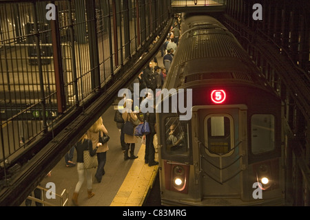No. 5 subway train pulling into the Union Square Station on the Lexington Line in NYC. - Stock Photo