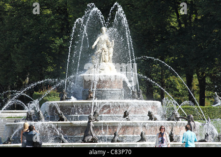 Tourists and the Latona Fountain in the Herrenchiemsee Gardens, Herreninsel Chiemsee Chiemgau Upper Bavaria Germany - Stock Photo