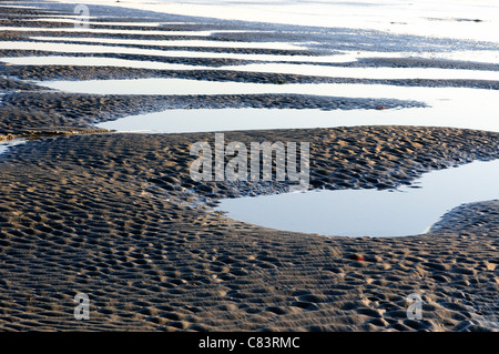 Patterns  in the sand from the water receding at low tide on West Wittering's  beach - Stock Photo