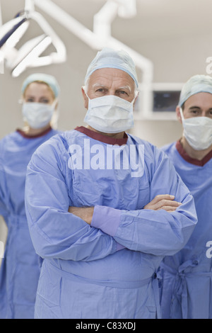 Team of doctors in operating room - Stock Photo