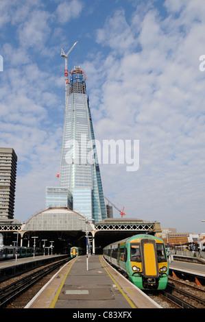 Work in progress Shard landmark skyscraper skyline building site under construction beyond London Bridge train station - Stock Photo