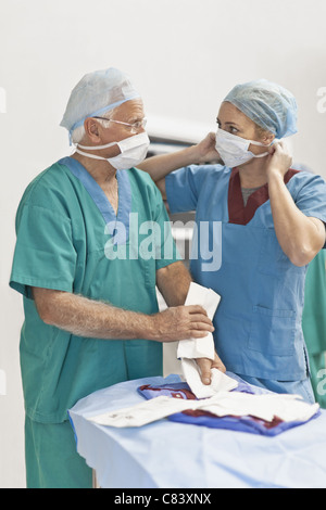 Doctor and nurse in operating room - Stock Photo