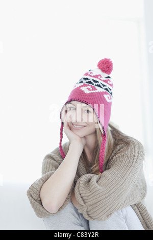 Smiling teenage girl wearing knitted hat - Stock Photo