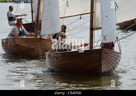 norfolk class dinghies racing on river waveney at beccles suffolk england - Stock Photo